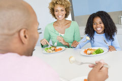 Family Eating A meal,mealtime Together Royalty Free Stock Image