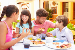 Family Eating Meal At Outdoor Restaurant Together Stock Photo