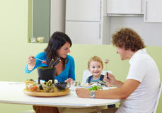 Family eating meat fondue Royalty Free Stock Image