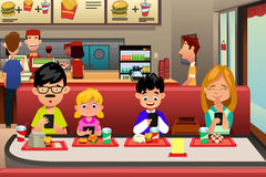 Family Eating Out in the Restaurant. A vector illustration of Family Busy with their electronic device while Eating Out in the Restaurant Stock Image