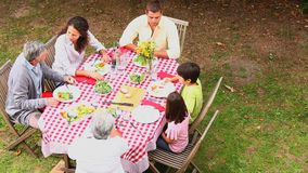 Family eating outdoors Royalty Free Stock Image