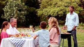 Family eating outdoors Stock Images