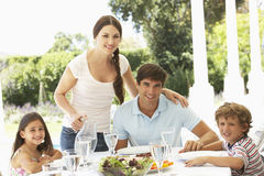 Family eating outisde together Royalty Free Stock Photography