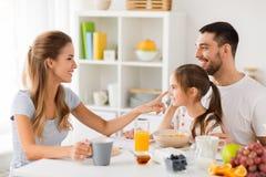 Happy family having breakfast at home Royalty Free Stock Image