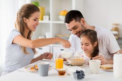 Happy family having breakfast at home Royalty Free Stock Images
