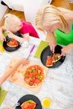 Family eating Pizza Royalty Free Stock Photos