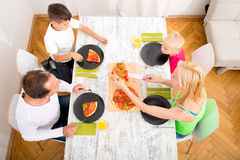 Family eating Pizza Stock Photos