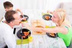 Family eating Pizza Stock Photos