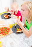 Family eating Pizza Royalty Free Stock Photo