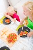 Family eating Pizza Stock Photo