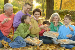 Family eating pizza in  park Royalty Free Stock Image