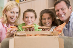Family Eating Pizza Together stock photo