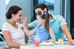 A family eating at the restaurant. On a sunny day royalty free stock images
