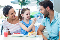 A family eating at the restaurant Stock Photo