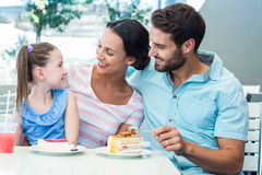 A family eating at the restaurant. On a sunny day royalty free stock photography