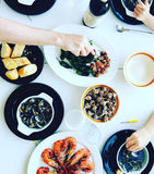 Family eating seafood in Spain. Flatlay of family eating seafood on white table in Spain in Summer Stock Photos