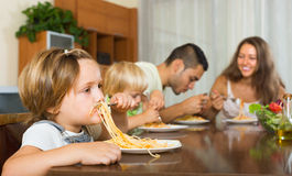 Family eating spaghetti Royalty Free Stock Images