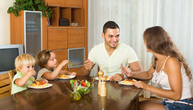 Family eating spaghetti Stock Photography