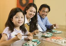 Family Eating Sushi Together portrait Royalty Free Stock Images