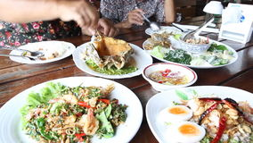 Family eating Thai food dinner,. Group of Thai food dinner, Thailand family stock video footage