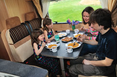 Family eating together in RV interior Royalty Free Stock Images