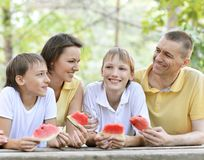 Family eating a watermelon Royalty Free Stock Photo