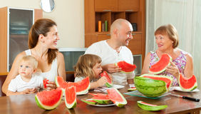 Family eating watermelon at home Royalty Free Stock Photo