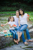 Family eating watermelon Royalty Free Stock Photos