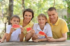 Family eating a watermelon Royalty Free Stock Image