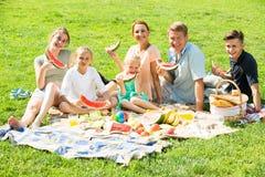 family eating watermelon Royalty Free Stock Photos
