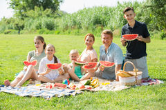 family eating watermelon Royalty Free Stock Image