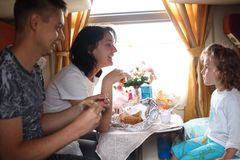 Family eats in train Royalty Free Stock Images