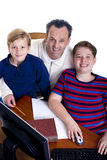 Family Education. A father with his two boys. Growing up, childhood, parenting, learning Stock Image