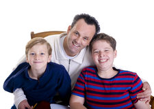 Family Education. A father with his two boys. Growing up, childhood, parenting, learning Stock Photos
