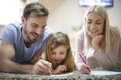 Coloring. Family working homework together. royalty free stock images