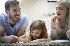 Educate. Family working homework together. stock images