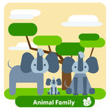 Family of elephants, tree, background, clouds Royalty Free Stock Photos