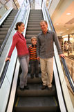 Family on elevator shop Stock Images