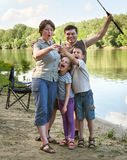Family with emotion catch fish, people camping and fishing, leisure in nature, river and forest, summer season Royalty Free Stock Photo