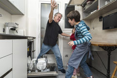 Family emptying the dishwasher Stock Photography