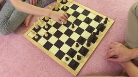 Family enjoy the chess. In room stock footage