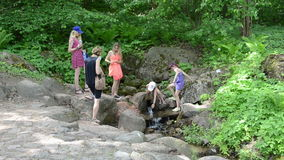 Family enjoy fresh source spring water in hot summer day stock video