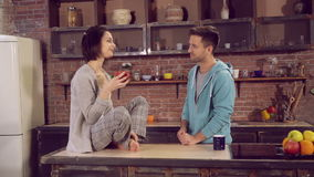 Family enjoy morning wearing in sleepwear talking and laughing. Family enjoy morning wearing iattentive and careful boyfriend with girlfriend spend morning at stock video