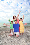 Family enjoy summer day at Florida beach. Stock Photos
