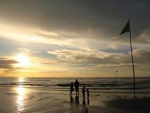 Family enjoy sunrise at the sea at Hua Hin beach, Thailand. royalty free stock photos