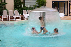 Family enjoy together in thermal pool Stock Image