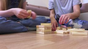 Family enjoy wooden tower game stock footage