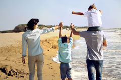 Family enjoyed walking on the beach at the sea Royalty Free Stock Image
