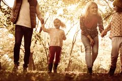 Family enjoying in autumn day. Close up. Cheerful family together in park. Close up stock photography