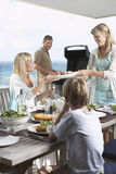 Family Enjoying A Barbecue Stock Photo